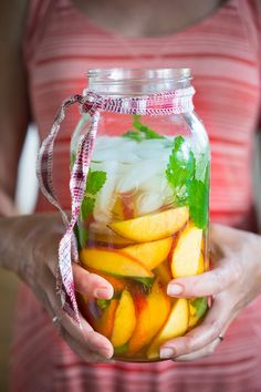 Peach and Elderflower Sangria…a refreshing sangria made with peaches, mint, white wine and St-Germain. #peachsangria #sangria #peaches