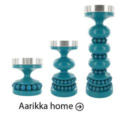 aarikka - candle holders ...love the color !