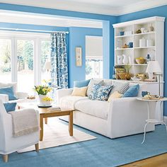 Adding the blue for its utter soothing and calming effect in the living room with major and small changes in walls, furniture and fabrics.