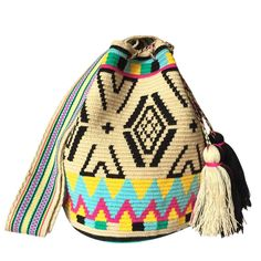 www.lombiaandco.com  The colors of this mochila Wayuu was inspired by the vivid colors that surround region of La Guajira. Sand, sea, desert, sun and a clear sky are constants in the landscape. Geometric figures are a signature ofthese mochila bags. #wayuubag Tapestry Bag, Tapestry Crochet, Knit Crochet, Knitting Patterns, Crochet Patterns, Desert Sun, Clear Sky, Knitting Accessories, Poufs