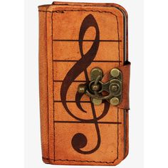 Unique handmade leather phone case for the Apple I-Phone 5 model phone with a Music Note Decoration on the front cover. This Artistic leather