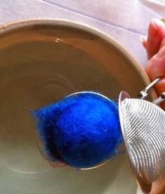 Making felted spheres using a tea-strainer