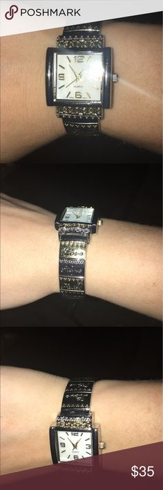 """Women's Quartz gold and silver watch Like new. Wore it once and then once today to take the pics. It's in great and working condition. It's gold and silver on the bands. There's writing on the bands. """"Love"""" """"Hope"""" """"Faith"""" """"Courage"""" """"Dream"""" """"Inspire"""". Asking $35 or OBO Jewelry Bracelets"""