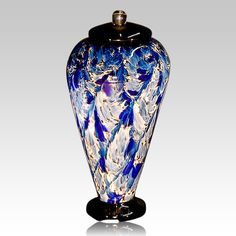 "The Blue Wave Glass Cremation Urn is hand blown one at a time. Each piece is unique and made for a special person.  Because each piece is handmade, colors and patterns will vary (The process for adding colors to molten glass is to ""roll"" raw molten glass in pigment glass like you would roll an ice cream cone in sprinkles."