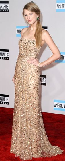 Taylor Swift in a glitzy Reem Acra gown. Love the emerald earrings too.