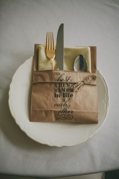 Utensil bags, made with a stamp, paperbag, and staples, can be made to fit any theme and add a wonderful detail to your reception.