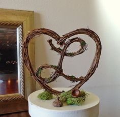 I love this! Would go cute with our decor. Wedding Cake Topper Rustic Heart with Letter  by AprilHilerDesigns, $34.00