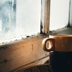 sitting on my bed against the window reading, drinking coffee, listening to the rain