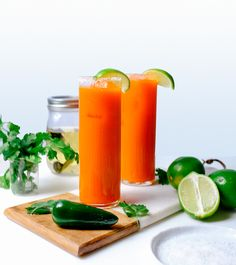 One of our favorite summer cocktails with a spicy kick. Spicy Drinks, Spicy Carrots, Jalapeno Margarita, Margarita Cocktail, Lime Wedge, Summer Cocktails, Simple Syrup, Coriander, Juicing