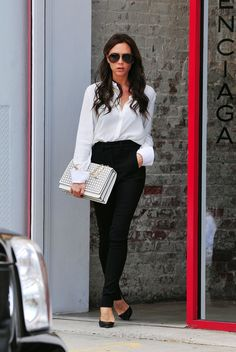 """WHO: Model, designer and former """"Spice Girls"""" member, Victoria Beckham WHAT: Harper's mama cut a sleek figure in black and white as she shopped around New York City earlier this week."""