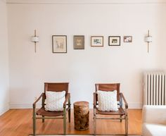 "The gallery wall is created from pictures Jess found in her parents' basement, as is one of her favorite elements: ""The receding gallery wall flanked with some awesome wall sconces I swapped out with the $12 Home Depot sconces that were there when I moved in."""