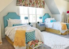 This shared girls bedroom has a bright design featuring white and pops of color. The space has a shiplap accent wall and whimsical decor /// Woodridge Parade of Homes Tour by Atkinson Drive Take You Home, Parade Of Homes, Cozy Corner, Interior Designing, Home Hacks, Home Staging, Kids Rooms, Girls Bedroom, Decorating Tips