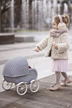 Dress for the weather and take a stroll in your neighborhood, greeting others. | Vivi & Oli-Baby Fashion