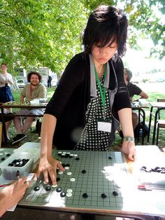 Simultaneous game between professionals of the Nihon Ki-in and amateurs at the European Go Congress 2011 in Bordeaux, France. Here is Xie Yimin.