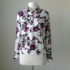 Silk floral printed blouse Blouson fit, notch collar and button front, banded hem with stretch smocking at back, 100% silk, Measurements in inches: bust 39.5, hip band 35, length 23.5, please keep in mind that hip band stretches White House Black Market Tops Blouses