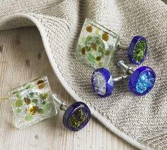 """Recycled Bottle Glass Knobs: Give a new look to cabinets and drawers with these recycled glass knobs. Made by a family-run studio, each is a hand made work of art. Made in USA. 1""""D x 2""""L"""