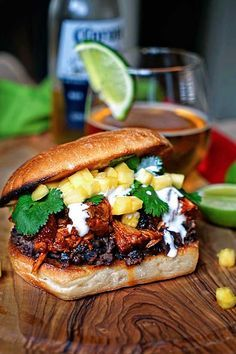 This slow simmered Pineapple Guajillo Chile Pulled Pork is stuffed in a ciabatta roll, layered on top of mashed black beans, a drizzle of Mexican crema, cilantro and diced pineapple. Sandwich Au Porc, Pork Sandwich, Mexican Sandwich, Pork Recipes, Mexican Food Recipes, Cooking Recipes, Lunch Recipes, Paninis, Ciabatta Roll