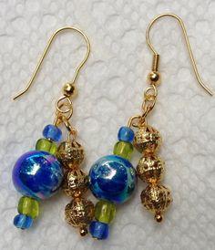 Blue and gold dangle earrings. by JewelryBySteve on Etsy, $6.00