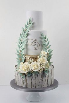 30 Must-See Rustic Woodland Themed Wedding Cakes ❤ woodland themed wedding cakes bottom layer with gray bark cake white with gold adorned with white flowers and foliage cake trends via instagram ❤ See more: http://www.weddingforward.com/woodland-themed-wedding-cakes/ #wedding #bride #weddingcakes #woodlandthemeweddingcake