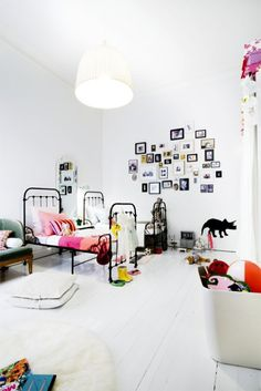 Girls room...love all the white with pops of color + shiny black furniture
