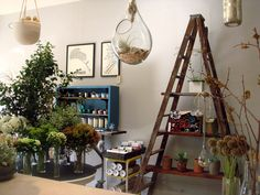 I seriously love everything about this little flower shop, but the ladder turned shelving is pretty cool.