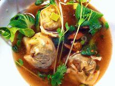 homemade vegan wontons in spicy ginger-temari stock + baby bokchoy, pea shoots, shiitake mushrooms, scallions, cilantro. (wontons have chinese broccoli, shallots, carrot, garlic, ginger, shiitake mushroom, seitan, waterchestnuts, cilantro, cumin, tamari, mirin, sesame oil, sichuan peppercorn)