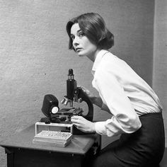 Audrey Hepburn with a microscope..