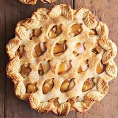 Decorative piecrust cutters are used to create the lattice top for this apple pie.