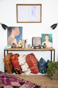 Using the Elm Display table as a console to display art, books + records for them Sagittarius's. | Patina