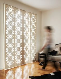 The DecoGlide features geometric and illustrative designs laser cut into panels made of wood or synthetic materials and then hung on a special track.  I so want this!