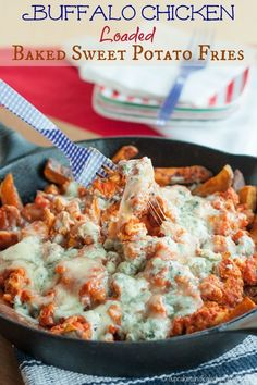 Buffalo Chicken Loaded Baked Sweet Potato Fries - these are insanely awesome gameday grub! Classic hot and spicy wings flavor in an ooey gooey pile of cheesy goodness | cupcakesandkalechips.com | gluten free recipe