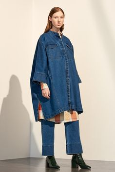 All about this oversized Kowtow denim cape coat. Style with straight leg jeans and block heels for a Canadian tuxedo that means business.