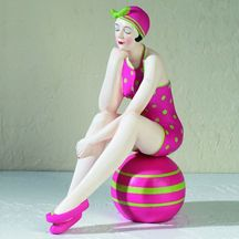 Liven up your home decor with this beautiful Bathing Beauty dressed up in a hot pink bathing suit with apple green polka dots, matching slippers and head scarf. This vintage beach girl is handcrafted and beautifully handpainted from head to toe. And let's not forget the matching beach ball! Have fun with home decor and enjoy your surroundings. For more information and to see our entire Bathing Beauty Figurine Collection, visit…