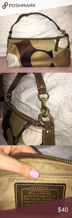 Coach bag Cute little coach bag with a brown, tan, olive green color scheme. Could be used as a makeup bag too. Great condition. Coach Bags Mini Bags