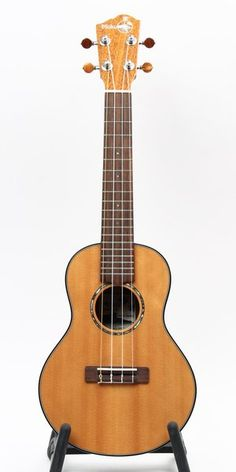 This Concert ukulele is set up with a wound low G string. It is constructed of all solid African mahogany back