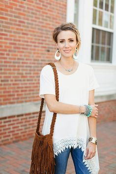 Lace trimmed tee, leather cut out earrings, fringe purse, stacked bracelets, and a braided bob. Perfection.