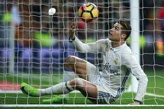 Cristiano Ronaldo Photos Photos - Cristiano Ronaldo of Real Madrid CF picks the ball after scoring their second goal during the La Liga match between Real Madrid CF and UD Las Palmas at Estadio Santiago Bernabeu on March 1, 2017 in Madrid, Spain. - Real Madrid CF v UD Las Palmas - La Liga