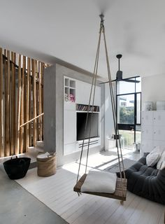 This home has a small kids tv area, with storage and a rope swing seat.