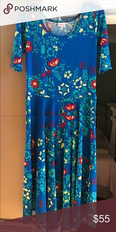 Floral XL Lularoe Nicole Dress! Gently used beautiful Lularoe Nicole! Worn and washed twice by LLR standards. Perfect condition. So vibrant and pretty just too big on me. Is the really soft and stretchy t shirt material. My loss is your gain! LuLaRoe Dresses Midi