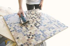 This DIY outdoor checkers game table has a secret! It doubles as a pretty mosaic top patio table. We have the complete tutorial for this DIY project. Outdoor Checkers, Tile Tables, Picnic Blanket, Outdoor Blanket, Patio Table, Table Games, Diy Projects, River, Bed