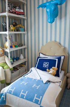 Designer: Liz Caan- Love the stripes, monogram pillow, Hermes blanket, blabla doll, shelving, carpeting, and whimsical steer's head- Like mixing shades of blue so room looks real  and not like a bed in a bag