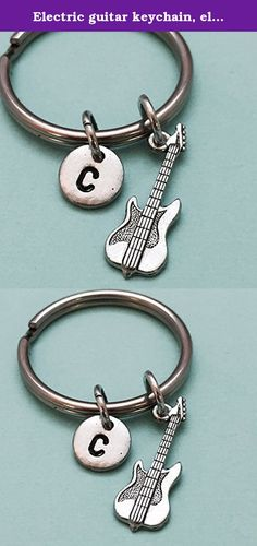 Electric guitar keychain, electric guitar charm, guitar keychain, musical instrument, music keychain, personalized keychain, monogram. Electric guitar charm keychain with hand stamped initial *Keychain is 32mm *Initial charm is antique silver pewter 9mm *Electric guitar charm is antique silver pewter *Your purchase will arrive packaged in a cute gift box and I will include a message by request.