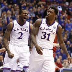 Kansas forward Cliff Alexander (2) celebrates a dunk by Kansas forward Jamari Traylor (31) as he glances toward the student section during the first half on Saturday, Jan.10, 2015 at Allen Fieldhouse.