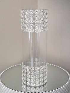 This is a very elegant vase that will give you that luxurious feel in todays modern weddings. The rhinestone ribbon around the vase will capture and enhance any lighting in the room and stand out with a glamorous look. Wedding Vase Centerpieces, Bling Wedding, Wedding Flower Arrangements, Wedding Centerpieces, Wedding Table, Wedding Decorations, Centerpiece Flowers, Centerpiece Ideas, Trendy Wedding