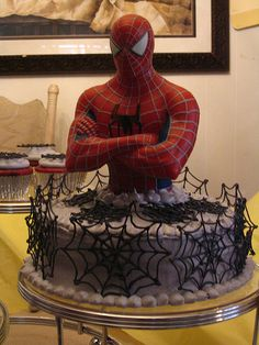 Spiderman cake - Ben would prefer an actual toy on top so he can play with it later, but I love the webs idea, should be fairly easy!