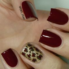I love this warm maroon mani with the gold, leopard accent.