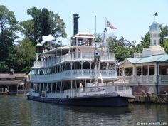 Liberty Belle Riverboat in the Magic Kingdom at Walt Disney World, FL has been operating since the park opened on Oct. 1, 1971. It is a 12 minute, 45 second cruise on the Rivers of America circling Tom Sawyer Island. The scenic tour offers a view of props along the riverbank to simulate a wild west effect. The boat holds about 450 people and has 3 decks.