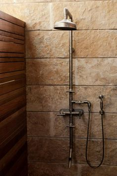 A rugged exposed-thermostatic shower set; Lake|Flato Architects