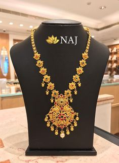 Enjoy this BIG SALE...Only @ NAJ NO WASTAGE* - NO MAKING - NO STONE COST Call or WhatsApp @ 9032041323 or email to mynaj@najindia.com... Available Only @ Naj Jewellery, Nellore.#TANAUSA, #TeluguUSA Necklace Holder, Name Necklace, Diy Necklace, Necklace Designs, Crochet Necklace, Gold Necklace, Glass Coating, Jewelry Patterns, Diamond Jewelry