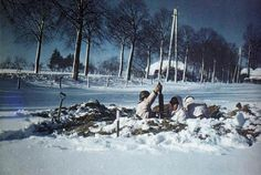 A US mortar team in a foxhole during the Battle of the Bulge in the snowy St. Vith